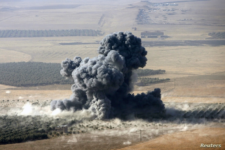 Smoke rises at Islamic State militants' positions in the town of Naweran, near Mosul, Iraq, Oct. 23, 2016.