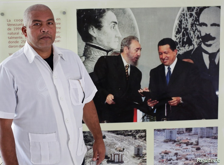 FILE - Cuban nurse Guillermo Ballines a day before his departure for Liberia during the Ebola crisis poses for a picture in Havana,  Oct.  21, 2014.