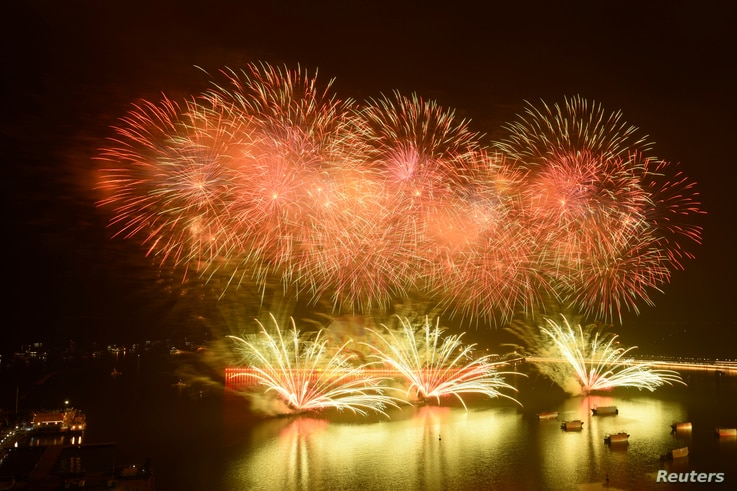 Fireworks light up the sky over Xiangzhou port of Zhuhai during a celebration to mark 40 years since Zhuhai became a city, in Guangdong province, China, March 5, 2019.