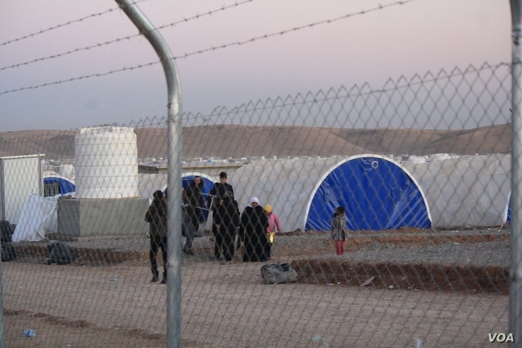 New families arrive at Hassan Sham camp say they fled to Iraqi Kurdistan regardless of IS death threats.  They say militants said they would be killed if they didn't serve as human shields.  (H.Murdock/VOA)