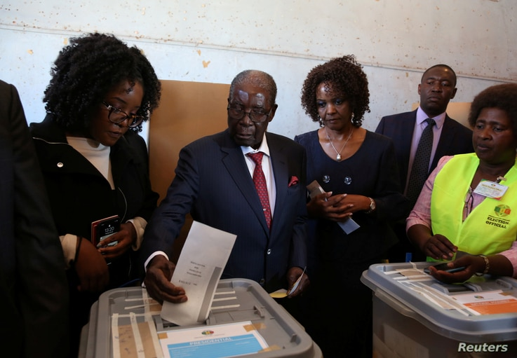 Zimbabwe's former president Robert Mugabe casts his ballot in the general elections in Harare, Zimbabwe, July 30, 2018.