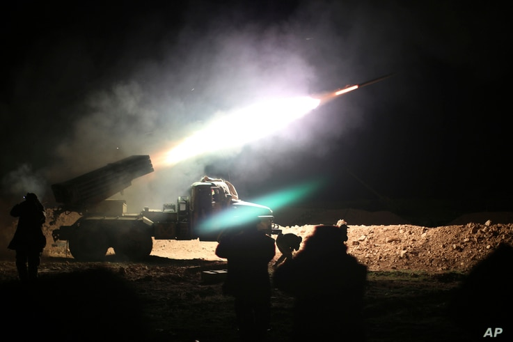 FILE - Soldiers from the Syrian army fire a rocket at Islamic State group positions in the province of Raqqa, Syria, Feb. 17, 2016.