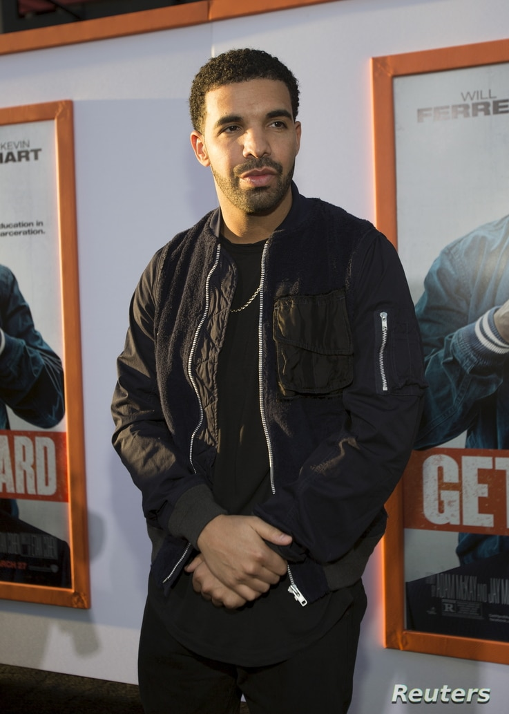 """FILE - Rapper Drake poses at the premiere of """"Get Hard"""" at the TCL Chinese theatre in Hollywood, Calif."""