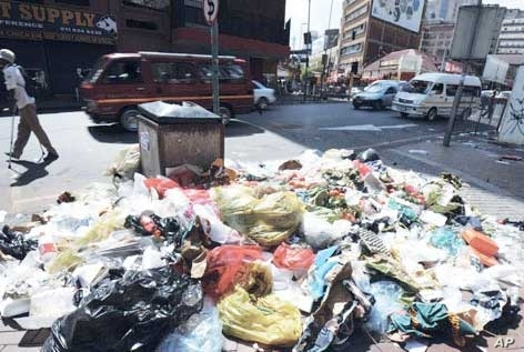 Johannesburg was hit by a strike by municipal workers that resulted in refuse piling up around the city just before the local government polls