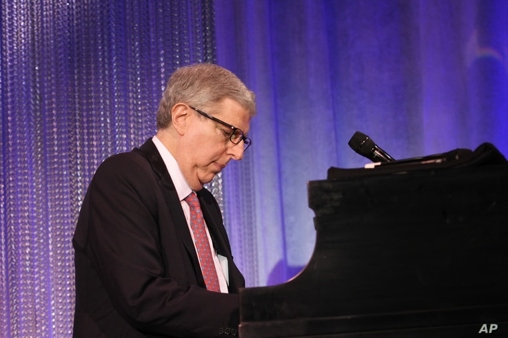 Composer Marvin Hamlisch performs at the Cedars-Sinai Board of Governors Gala at The Beverly Hilton Hotel in Beverly Hills, California, November 8, 2011.