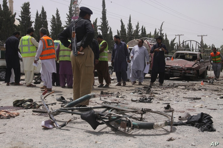 Pakistani security personnel visit the site of bombing in Quetta, Pakistan, July 25, 2018.
