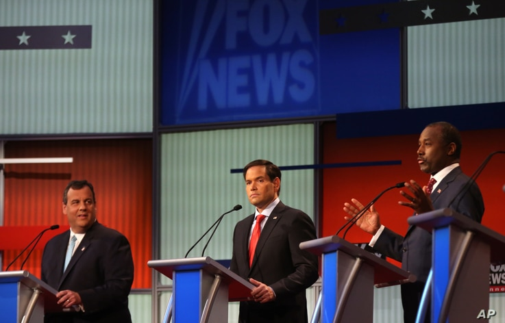 Chris Christie, Marco Rubio and Ben Carson take the stage for the first Republican presidential debate, Cleveland, IN, Aug. 6, 2015.