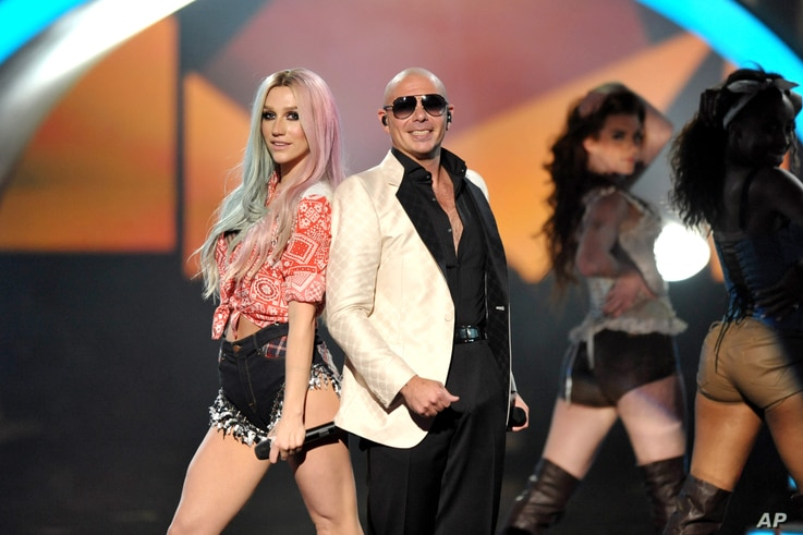 Ke$ha, left, and Pitbull perform at the American Music Awards at the Nokia Theatre L.A. Live on Nov. 24, 2013, in Los Angeles.