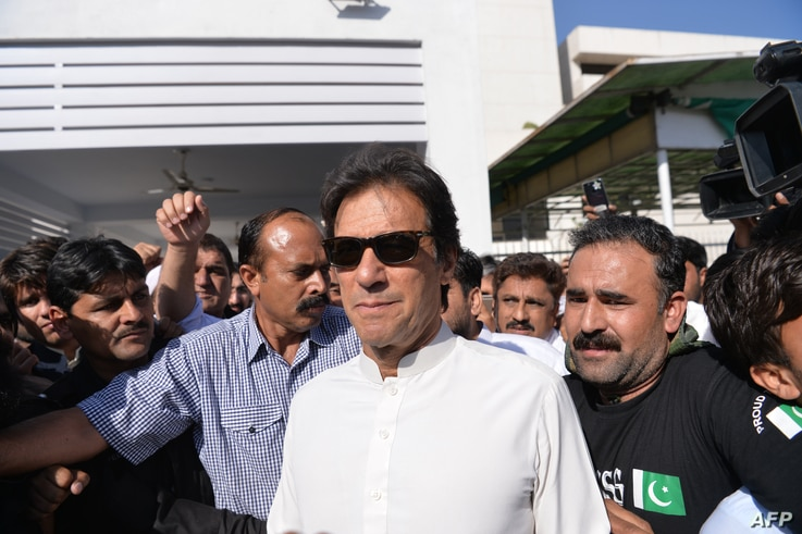 Pakistan opposition leader and head of the Pakistan Tehreek-e-Insaf (PTI, Pakistan Movement for Justice) political party Imran Khan leaves Parliament after attending a session in Islamabad, May 23, 2018. Pakistan passed legislation on May 24 paving t...
