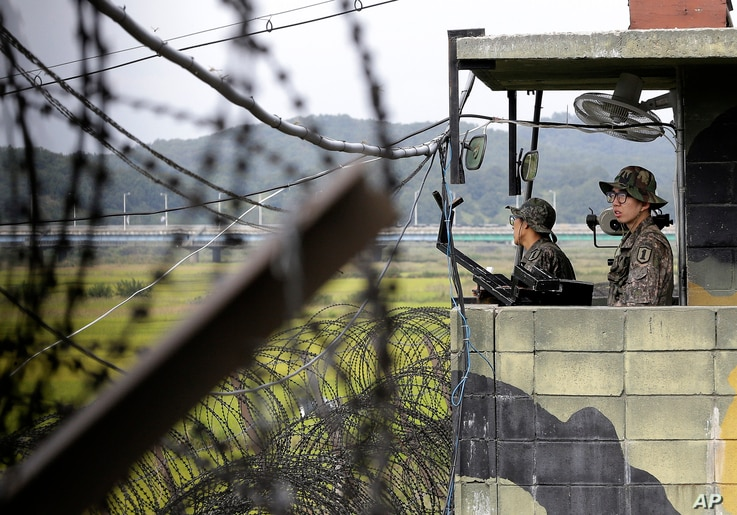FILE - South Korean army soldiers stand guard at a military check point at the Imjingak Pavilion near the border village of Panmunjom, which has separated the two Koreas since the Korean War, in Paju, South Korea.