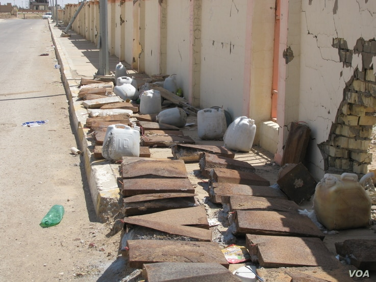 IED's found in residential area in Ramadim, filled with homemade explosive (HME).  (Credit: Janus Global)