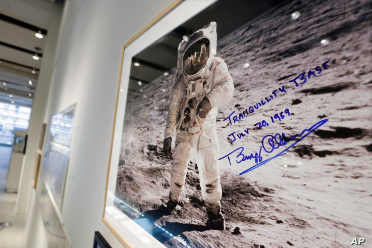 "A print of astronaut Neil Armstrong's photograph of fellow Apollo 11 astronaut ""Buzz"" Aldrin standing on the moon, to be offered at auction at Sotheby's, is displayed in New York, July 13, 2017."