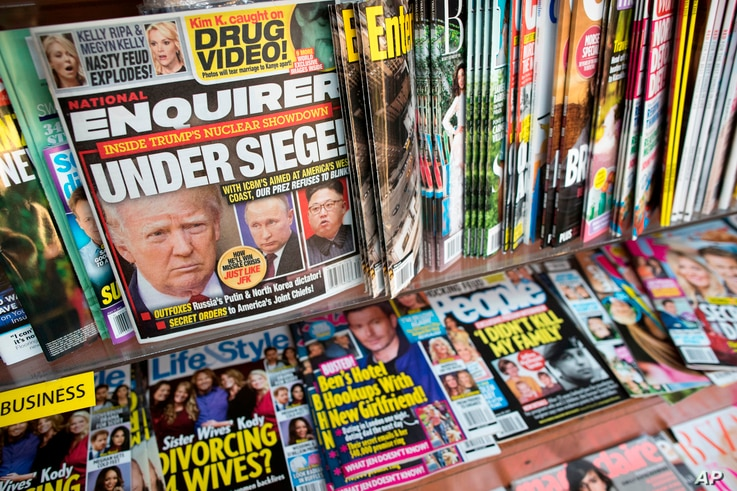 FILE - This July 12, 2017, file photo shows the cover of an issue of the National Enquirer featuring President Donald Trump at a store in New York. Karen McDougal, a former Playboy model who said she had a 10-month affair with President Donald Trump,...