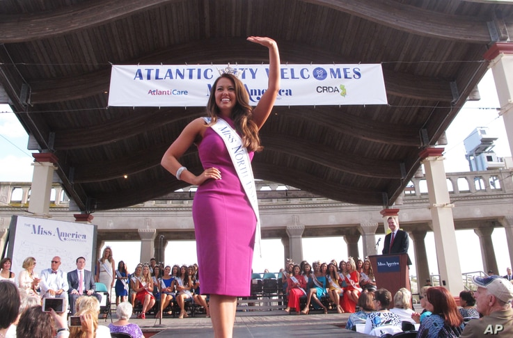 In this Aug. 30, 2017, photo, Miss North Dakota Cara Mund waves during a welcoming ceremony for Miss America contestants in Atlantic City, New Jersey. Her goal is to become the first women elected governor of North Dakota.