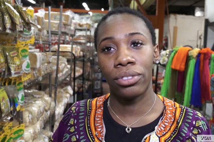 """Deandra Harris, a cashier at Gold Coast Trading Company — a West African goods market based in the Bronx, New York, says, """"If you do not vote, you're kind of just giving your vote away to whomever does."""""""