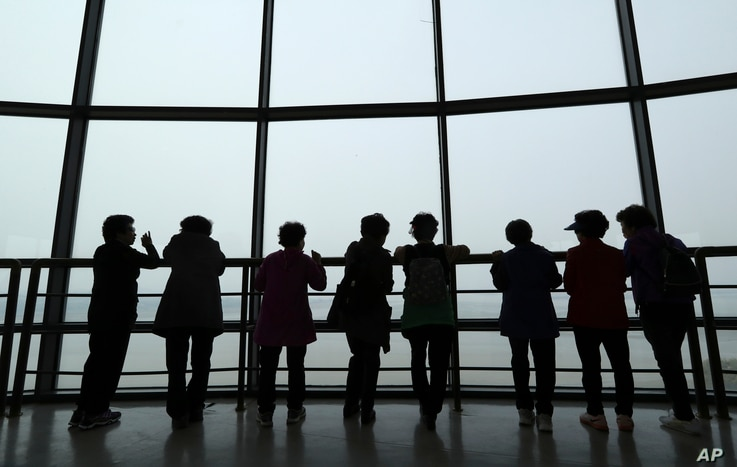 Visitors watch the North Korea side from the unification observatory in Paju, South Korea, April 25, 2017.