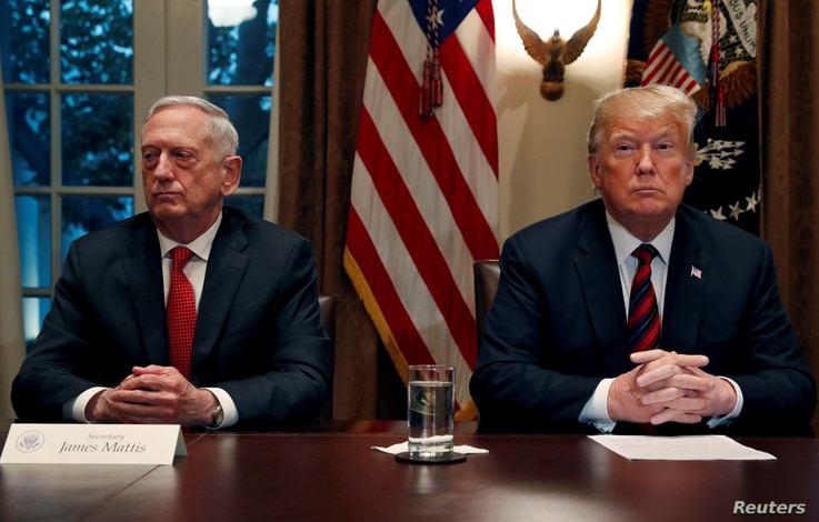 FILE - U.S. President Donald Trump speaks to the news media while gathering for a briefing from his senior military leaders, including Defense Secretary James Mattis (L), in the Cabinet Room at the White House in Washington, U.S., Oct. 23, 2018.