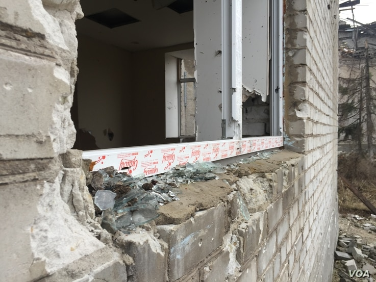 The glass appears freshly shattered, but is from the shelling of two years ago, Donetsk region, Ukraine, March 6, 2016. (L. Ramirez/VOA)