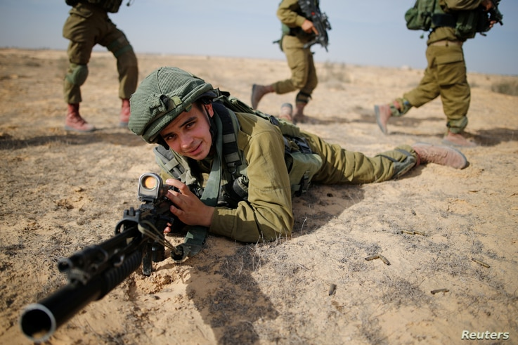 Saleh Khalil, 20, an Israeli Arab soldier from the Desert Reconnaissance battalion takes part in a drill near Kissufim in southern Israel, Nov. 29, 2016.