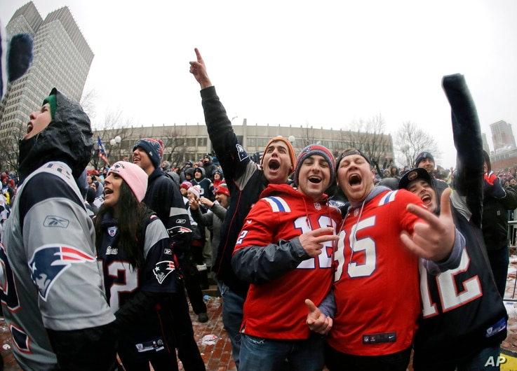 FILE - New England Patriots fans cheer at city hall plaza during a rally Feb. 7, 2017, in Boston, to celebrate the team's win over the Atlanta Falcons in the Super Bowl.