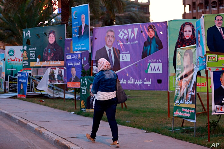 Campaign posters for parliamentary elections adorn a street in Baghdad, Iraq, April 30, 2018.