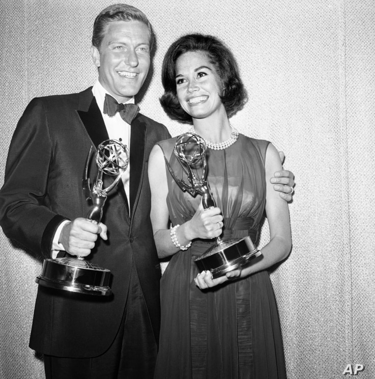 Dick Van Dyke, left, and Mary Tyler Moore co-stars of The Dick Van Dyke Show pose backstage at the Palladium with the Emmys won in the Television Academys 16th annual awards show, May 25, 1964, Los Angeles, Calif.