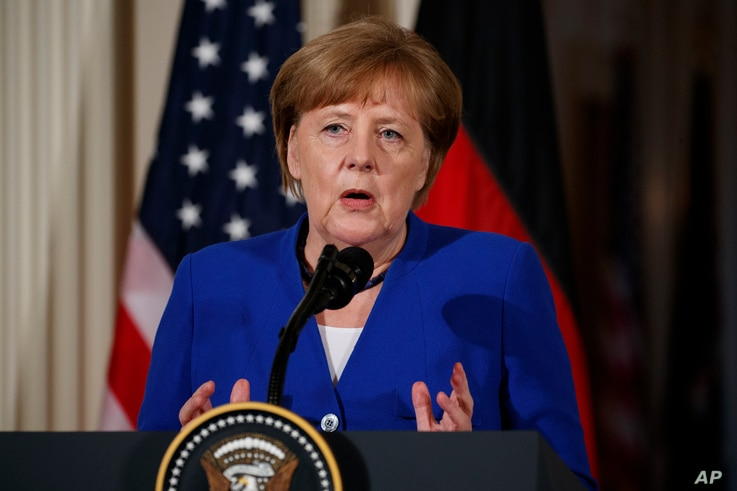 German Chancellor Angela Merkel speaks during a news conference with President Donald Trump in the East Room of the White House, April 27, 2018, in Washington.