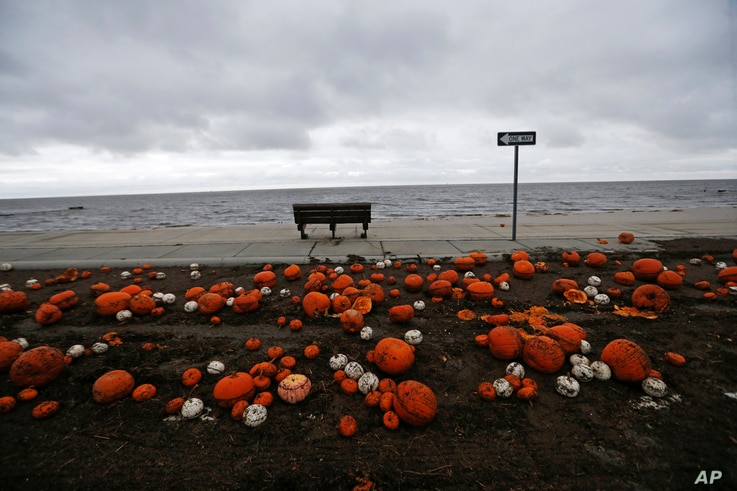 Pumpkins are strewn along the Gulf of Mexico in Pass Christian, Miss., in the aftermath of Hurricane Nate, Oct. 8, 2017.