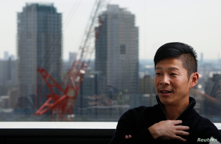FILE - Yusaku Maezawa, chief executive of online fashion retailer Start Today Co, speaks during an interview with Reuters at the company headquarters in Chiba, March 27, 2012.