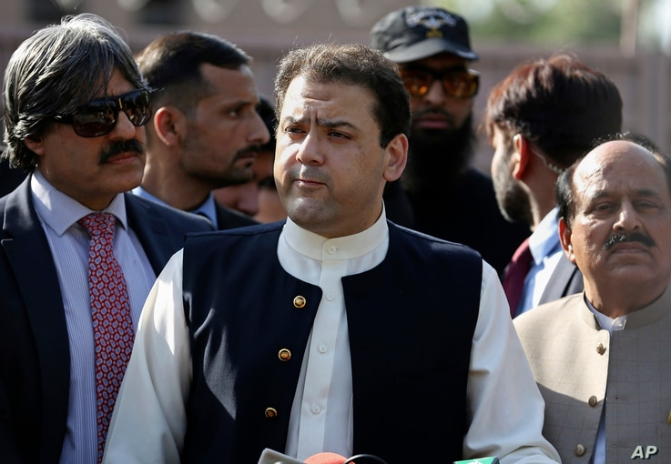 Hussain Nawaz, center, son of Pakistan's Prime Minister Nawaz Sharif, talks to reporters outside the premises of the Joint Investigation Team, in Islamabad, Pakistan, June 1, 2017, following his appearance before the panel.