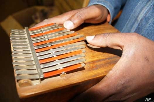 Hugh Tracey's simpler version of the mbira…. He called it the kalimba