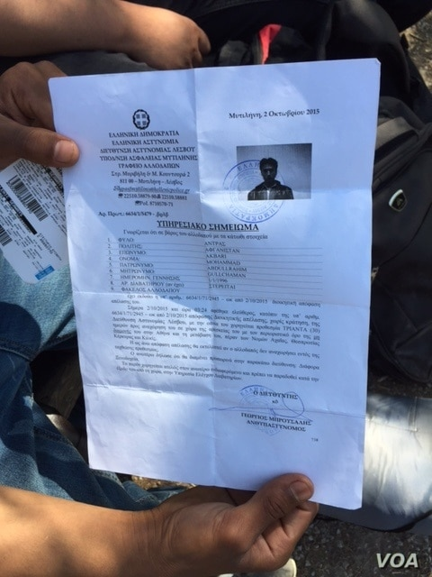 Mohamed Eckberry's ticket and registration paper for the ferry to Athens. (Jeff Swicord/VOA News)