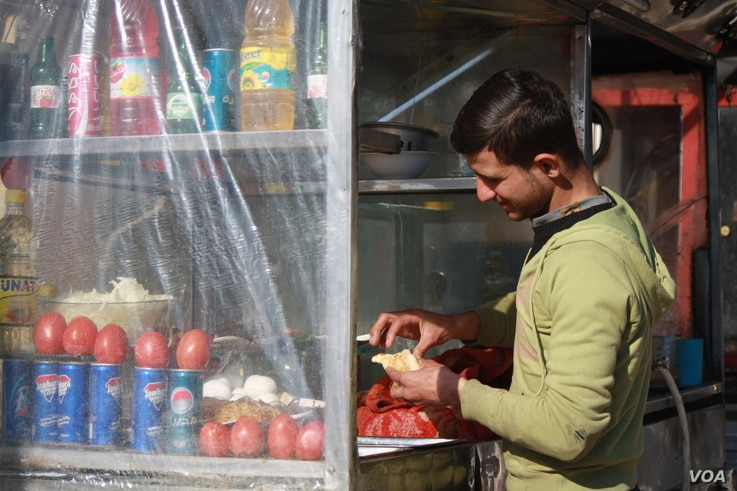 t a cafe in The Apartments, a densely populated urban complex, locals say fighting in their area was fierce and soldiers had to operate on foot because the roads are too narrow for Humvees to navigate, in Mosul, Iraq, Feb. 8, 2017 in Mosul, Iraq. (H....