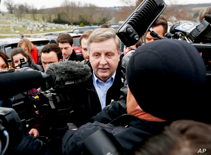 Republican Rick Saccone, center, is surrounded by cameras and reporters as he heads to the polling place to cast his ballot in McKeesport, Pennsylvania, March 13, 2018.
