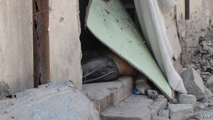 Bodies of IS militants litter the streets and buildings in the areas of Old Mosul recently captured, while the bodies of families are buried in the rubble in Mosul, Iraq, June 25, 2017..