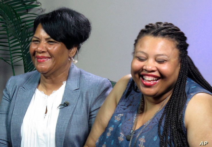 Alice Marie Johnson, left, and her daughter Katina Marie Scales wait to start a TV interview, June 7, 2018 in Memphis, Tennessee.