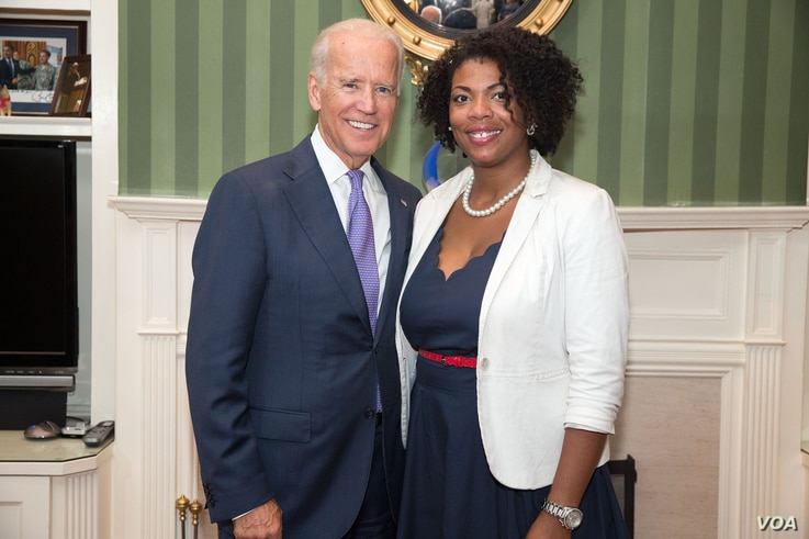 Vice President Joe Biden takes photos with attendees at a reception for the 20th Anniversary of the Violence Against Women Act, in the library of the Naval Observatory Residence, in Washington, D.C., Sept. 9, 2014.  (Official White House Photo / Davi...