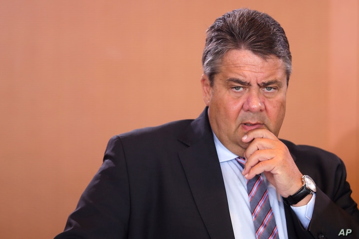 FILE - German Vice Chancellor and Economy Minister Sigmar Gabriel arrives for the weekly cabinet meeting of the German government at the chancellery in Berlin, June 22, 2016.