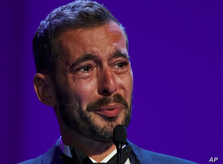 "Director Xavier Legrand gets emotional after being awarded the Silver Lion for best director for ""Jusqu'a la Garde"" during the awards ceremony at the 74th Venice Film Festival at the Venice Lido, Italy, Sept. 9, 2017."