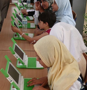 Gilrs in Najmi, Muthanna province, Iraq with OLPC computers.