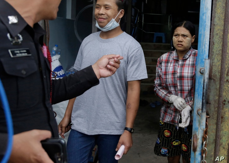 Burmese workers Tin Nyo Win, left, and Mi San smile upon being reunited in Samut Sakhon, Thailand, Nov. 9, 2015. They were separated while trying to escape the shrimp shed where they were held as slaves. Tin, labeled No. 31, sought help from a labor ...