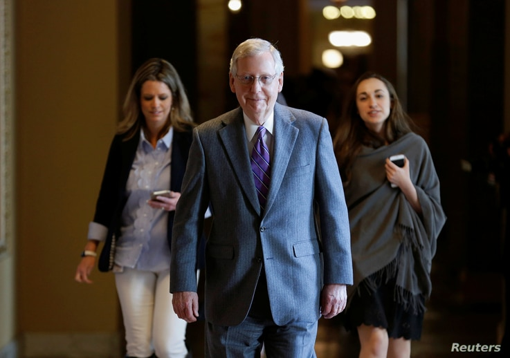 Senate Majority Leader Mitch McConnell (R-KY) walks to the Senate floor before a series of votes on immigration reform on Capitol Hill in Washington, U.S., Feb. 15, 2018.