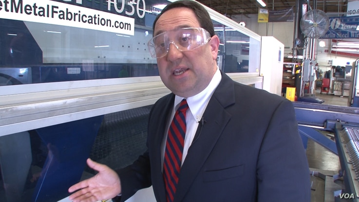 Marlin Steel owner Drew Greenblatt says rules to lower greenhouse gas emissions will raise his costs. (S. Baragona/VOA)