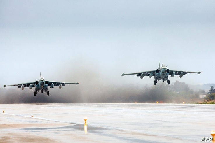 FILE - A handout picture taken on March 16, 2016 and released by the Russian Defense Ministry shows Russian Sukhoi Su-25 ground attack aircraft taking off from the Hmeimim military base in Latakia province, Syria. (Russian Defense Ministry/Vadim Gris