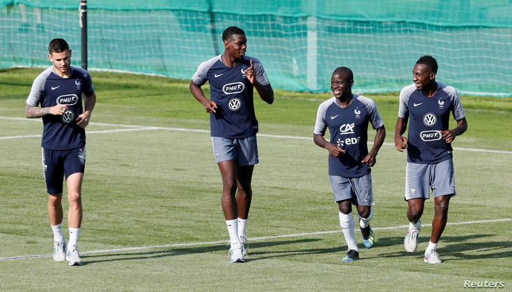 France's Lucas Hernandez, Paul Pogba, N'Golo Kante and Blaise Matuidi at France's training site in Moscow, July 12, 2018.