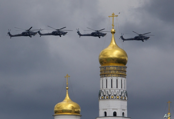 Russian military helicopters fly over Ivan the Great bell-tower and Moscow's Kremlin during a general rehearsal for the Victory Day military parade which will take place at Moscow's Red Square on May 9 to celebrate 71 years after the victory in WWII