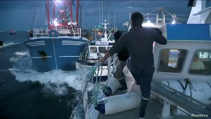 French and British fishing boats collide during a scrap in English Channel over scallop fishing rights, Aug. 28, 2018, in this still image taken from a video.