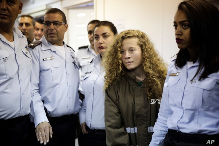 Ahed Tamimi is brought to a courtroom inside Ofer military prison near Jerusalem, Dec. 28, 2017.