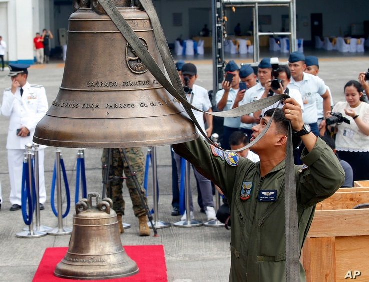 Philippine Air Force personnel unload three church bells seized by American troops as war trophies more than a century ago, as they arrive in suburban Pasay city southeast of Manila, Philippines, Dec. 11, 2018.