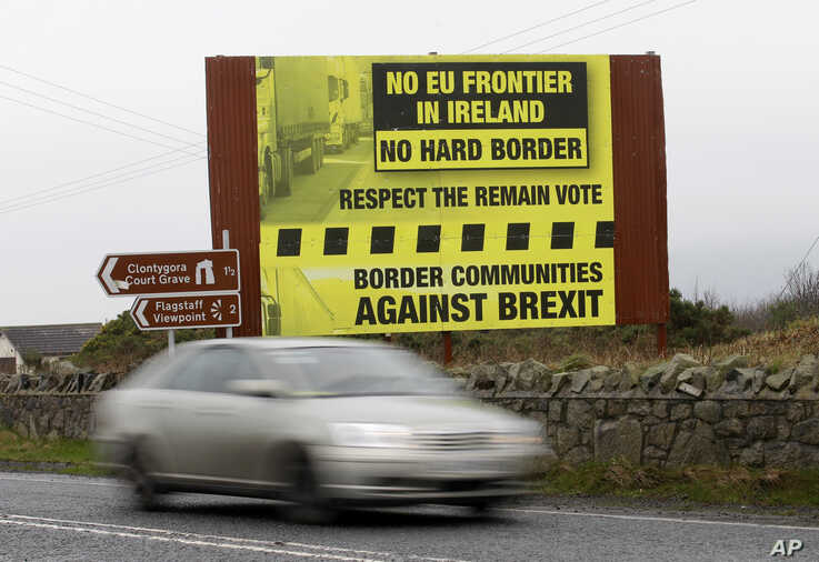 FILE - A car crosses over the border from the Irish Republic into Northern Ireland near the town of Jonesborough, Northern Ireland, Jan. 30, 2017. After Britain leaves the EU in 2019, the 500-kilometer (310-mile) border between Northern Ireland and I...